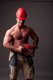 Muscular construction worker. With drill Stock Image