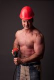 Muscular construction worker Stock Photography