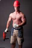 Muscular construction worker. With drill Stock Photo