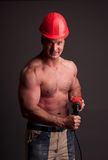 Muscular construction worker Stock Images