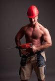 Muscular construction worker Stock Photos