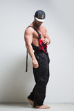 Muscular construction worker in overalls Royalty Free Stock Images