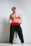 Muscular construction worker in overalls Stock Photography