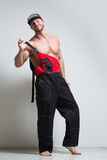 Muscular construction worker in overalls Stock Photos
