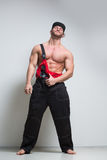 Muscular construction worker in overalls Royalty Free Stock Image