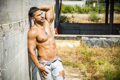 Muscular construction worker shirtless in building Royalty Free Stock Images