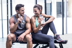 Muscular couple discussing on the bench Stock Image