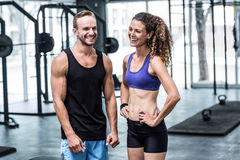 A muscular couple discussing together Royalty Free Stock Photos