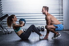 Muscular couple doing abdominal ball exercise Stock Photography
