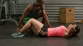 Muscular couple doing abdominal exercises stock footage