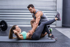 Muscular couple doing abdominal exercises Royalty Free Stock Photo