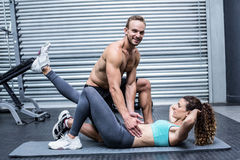 Muscular couple doing abdominal exercises Royalty Free Stock Image