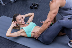 Muscular couple doing abdominal exercises Stock Photo