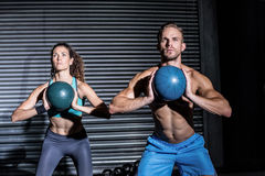 Muscular couple doing ball exercise Royalty Free Stock Photo