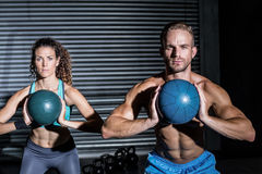Muscular couple doing ball exercise Stock Image