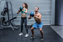 Muscular couple doing ball exercise Royalty Free Stock Photography