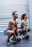 Muscular couple doing ball exercise Stock Images