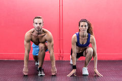 Muscular couple doing body stretching Stock Photography