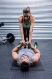 Muscular couple doing core exercises Stock Image