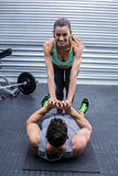 Muscular couple doing core exercises Royalty Free Stock Image