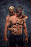 Muscular couple embracing stock photo