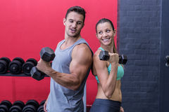 Muscular couple giving back to back Stock Images