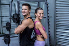 Muscular couple giving back to back Royalty Free Stock Photos