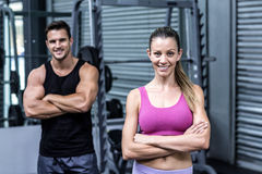 Muscular couple looking at the camera royalty free stock photo