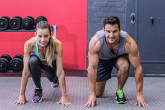 Muscular couple on the starting position Royalty Free Stock Photo