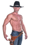 Muscular cowboy. With gun on white background Royalty Free Stock Image