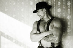 A muscular cowboy in a felt hat  Stock Images