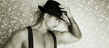 A muscular cowboy in a felt hat  Royalty Free Stock Image