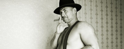A muscular cowboy in a felt hat  Royalty Free Stock Images