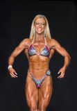 Muscular and Defined Fitness Athlete in Bikini Stock Photography