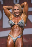 Muscular, Defined Redhead Shines at Women`s Physique Contest Stock Images
