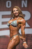 Muscular, Defined Redhead Shines at Women`s Physique Contest Royalty Free Stock Photo