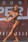 Muscular, Defined Redhead Shines at Women`s Physique Contest Royalty Free Stock Photography