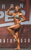 Muscular, Defined Redhead Shines at Women`s Physique Contest Stock Image