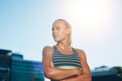 Muscular female athlete in outdoors stadium Royalty Free Stock Photography