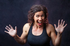 Muscular Female Weight Lifter Being Goofy Royalty Free Stock Photo