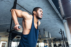 Muscular Fit Man Doing Pull Ups in the gym Royalty Free Stock Image