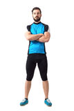 Muscular fit sportsman cyclist in sportswear with crossed arms looking at camera Royalty Free Stock Photos