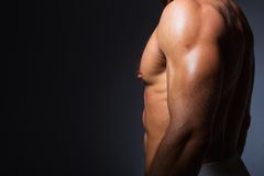Muscular and fit torso of young sporty man showing Stock Photo
