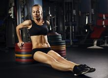 Muscular fit woman exercising building muscles Royalty Free Stock Photography