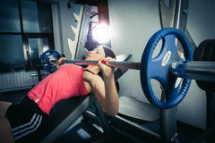 Muscular fit woman exercising. stock photo