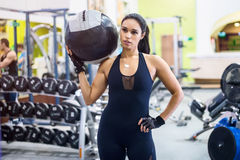Muscular fit woman workout in gym. Strong female royalty free stock photography