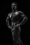 Muscular and fit young bodybuilder fitness male model posing ove Royalty Free Stock Photography