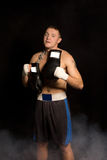 Muscular fit young boxer preparing for a fight Royalty Free Stock Photo