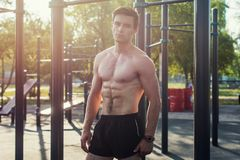 Muscular fitness male model posing shirtless demonstrating six packs abs royalty free stock photos
