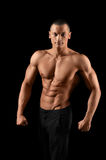 Muscular fitness man on black background Stock Images